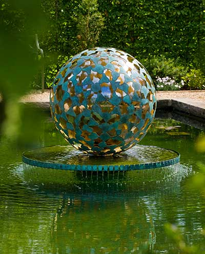 Mantle bronze outdoor water sculpture with gold leaf interior