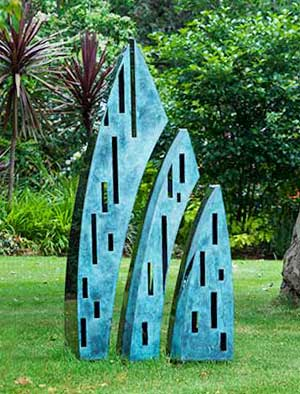 Tall Outdoor Sculpture Comprising A Trio Of Bronze And Stainless Steel  Elements That Appear To Split