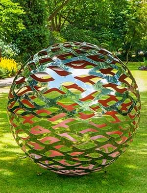 Marvelous Modern Garden Sphere Made From A Lattice Of Stainless Steel With A Coloured  Interior