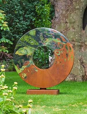 Metal garden sculpture made from rusty oxidized steel and mirror polished  stainless steel