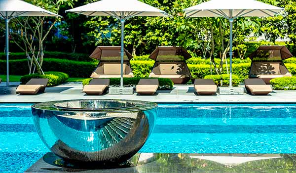 Chalice water feature adorns swimming pool at Singapore condos