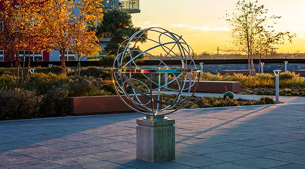 Armillary sphere in a peaceful spot at the Liberty Center mixed use development