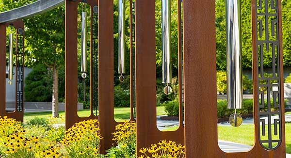 Giant wind chimes sculpture in corten steel