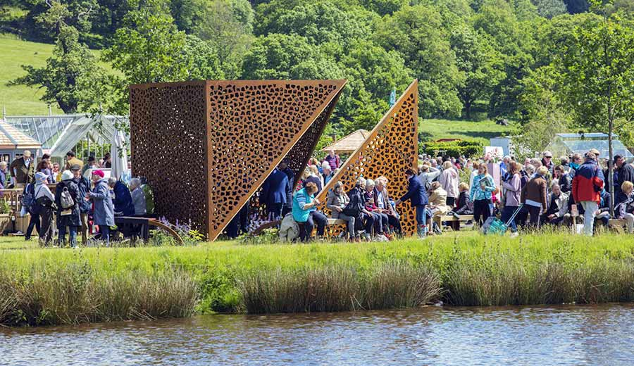 Crowds around the Cube sculpture at Chatsworth flower show
