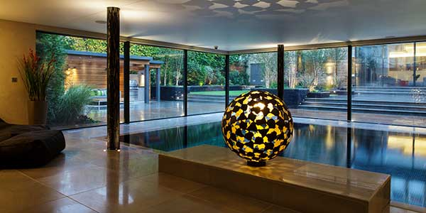 Interior contemporary spherical sculpture made of bronze