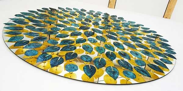 Beautiful sculpture logo made of 160 verdigris leaves