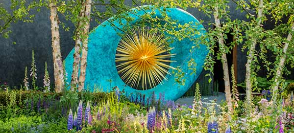 Massive Aeon sculpture in its setting in the Chelsea Show Garden