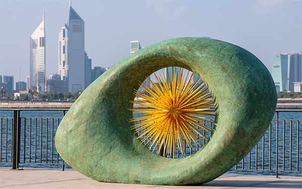 Aeon sculpture against the Dubai skyline
