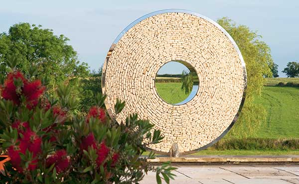 Torus garden sculpture in cotswold stone to match its location