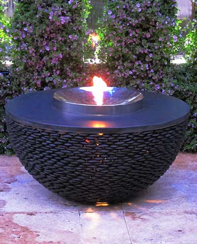 Fire table in pretty garden