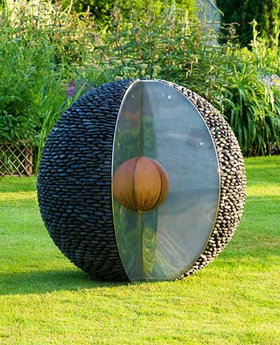 The Kernel Pebble Sculpture Bathed In The Light Of The Setting Sun. This  Polished Stone Garden ...