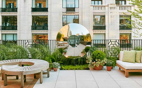 Stainless steel Torus on New York roof terrace