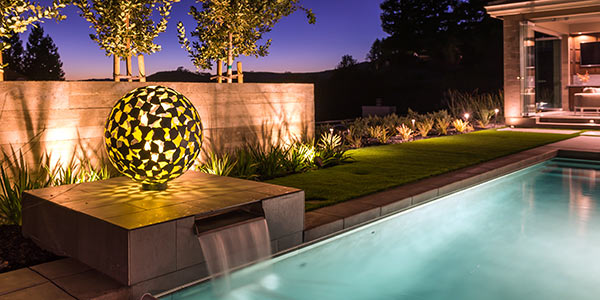 Mantle modern outdoor sculpture by swimming pool