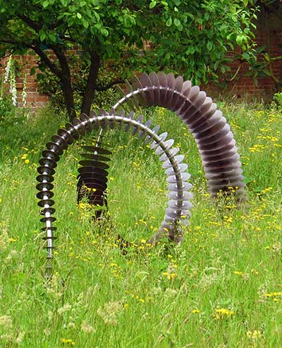 Coluna garden art twisting and turning in grass