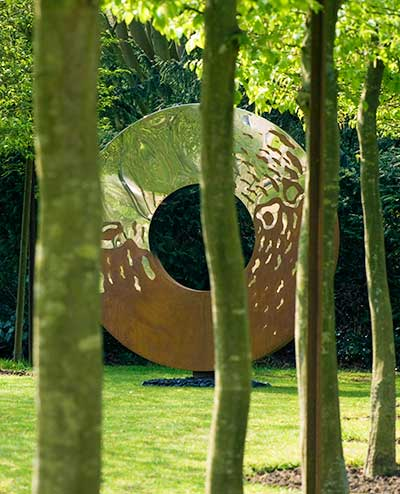 Portal large garden sculpture in two interwoven metals