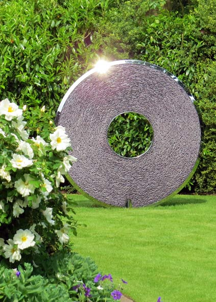 Slate Torus sculpture in a garden