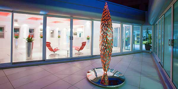Stainless steel Quill sculpture in office courtyard
