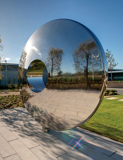 Looking at the Torus contemporary sculpture from the side, showing reflections