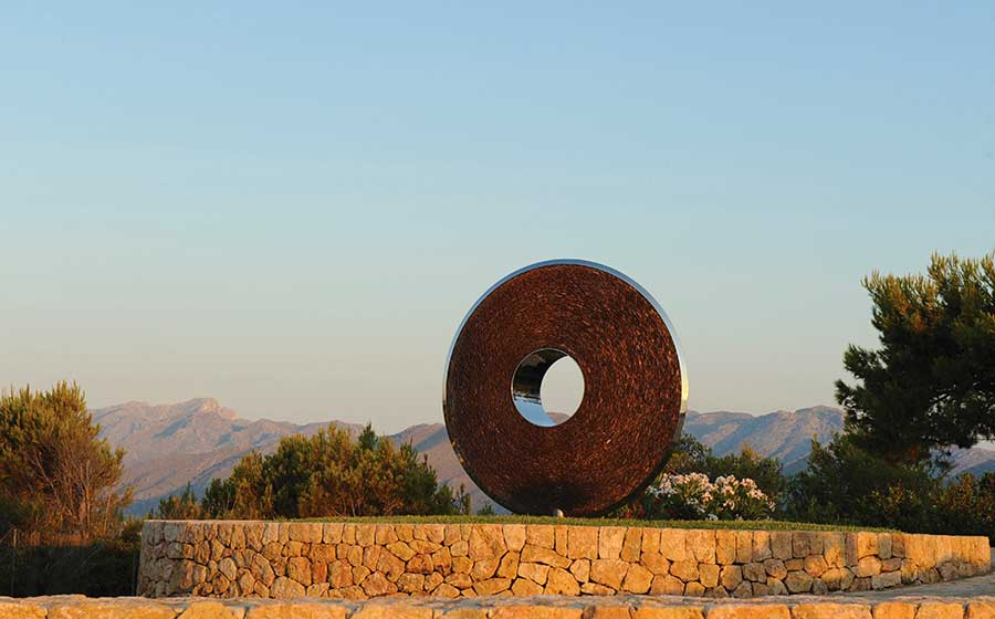 Slate and steel Torus sculpture installed in a Majorcan landscape