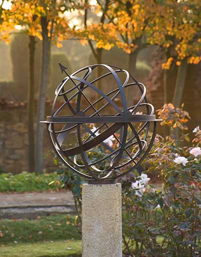 Bronze armillary sundial in the autumn