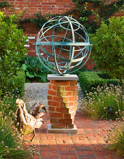 Bronze armillary sphere on unusual twisted brick plinth