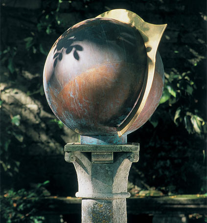 Copper globe garden sundial set amidst plants, based on a 16th century French design