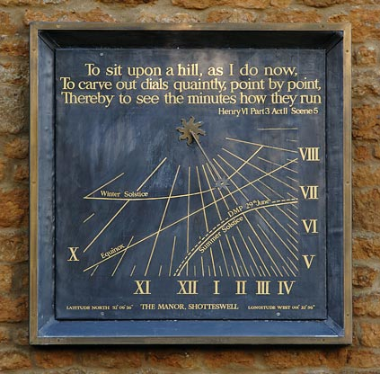 Lead wall sundial with motto