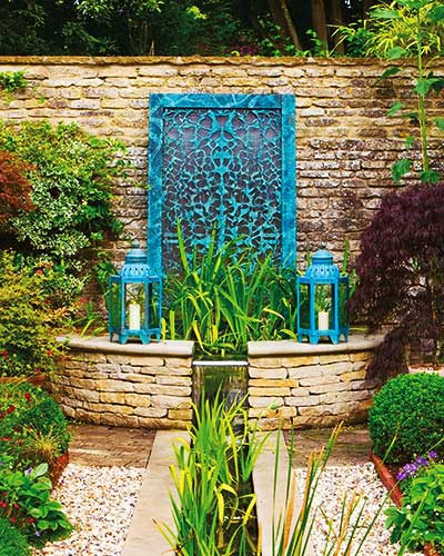 Filligree water wall in verdigris bronze