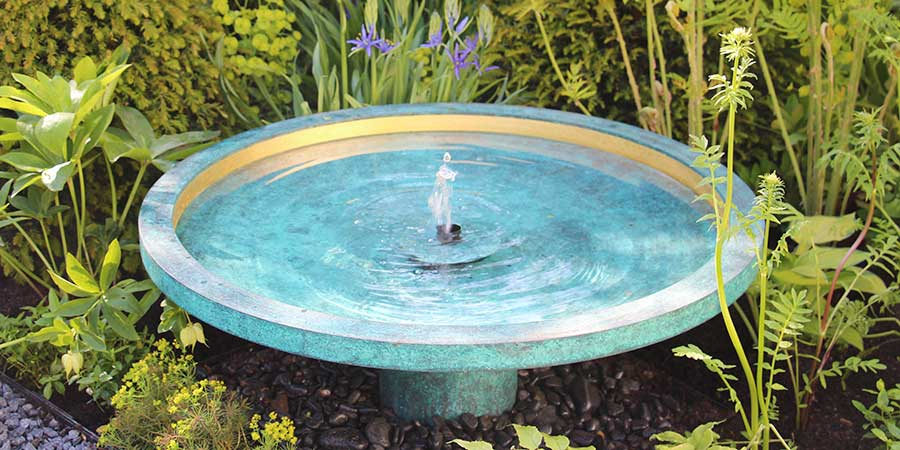Ekho classic water feature amongst flowers