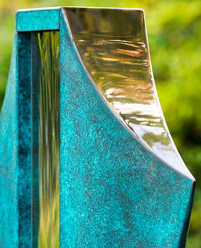 Detail of the bronze and stainless steel of the Volante water feature