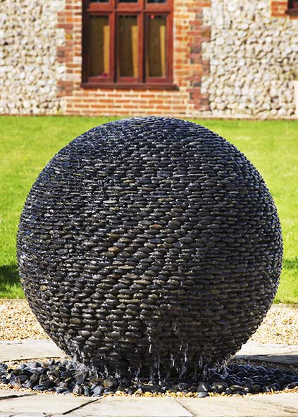 Water Ball Fountain Of Black Pebbles