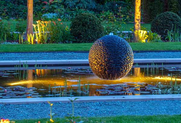 Dark Planet water sphere garden sculpture