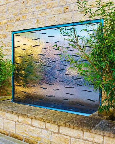 Outdoor contemporary steel wall art etched with Bronze Waves