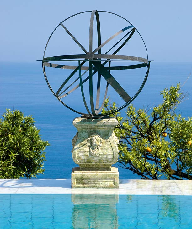 Armillary garden sundial by swimming pool
